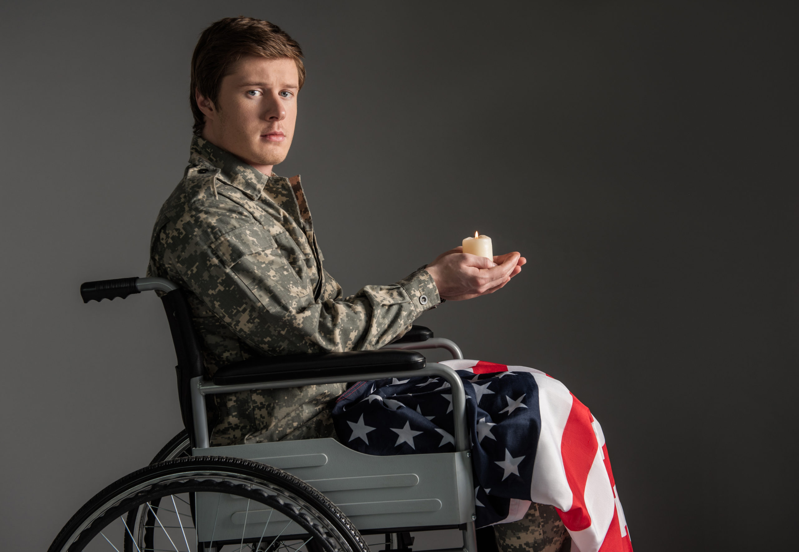 VA disability attorney concept. Unhappy paralyzed military man feeling helpless
